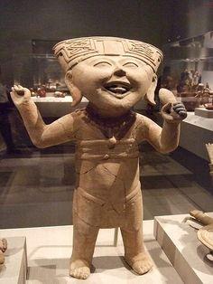 Smiling figure holding a rattle Mexico Remojadas culture Veracruz Late Classic Period 6th-8th century CE Earthenware by mharrsch, via Flickr