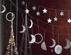 $88.00 Roost Phases of the Moon & Star Garland Our silvery Phases of the Moon Garland captures the magic of the waxing, waning, new and full moons. Hand-cut from iron sheets, each piece is plated with silver to create a shimmering textural finish resembling the lunar surface.