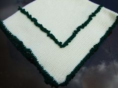 """Handcrafted blanket handmade crochet cream green baby blanket afghan. Carefully hand crocheted by me with love and tenderness. Cream wool with a lovely deep green contrast works well for both boy or girl.    This simple yet effective blanket is warm and ideal for baby or toddler. Made in a non smoking and pet free environment.    Size 34"""" x 32"""" or 86cm x 80cm    The cream wool is 65% wool and the remainder is mixed fibres.  The green is a mixed fibres and is really used for contrast.    Wash…"""