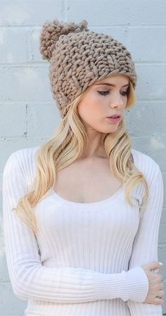Beanie Around the World Add a cheerful note to your winter ensemble with this chunky knit beanie. So cute and stylish with a classic pom pom on top (and hey, if your not a pom pom kind of gal, it can easily be removed with a little snip from your scissors). The hardest decision you are going to have to make is choosing a colour! Available in Black, Ivory, Mint, Mocha or Pink.  Chunky Knit Beanie Dimensions 9 inches x 18 inches 100% Acrylic