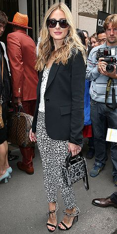 Love Her Outfit! | OLIVIA PALERMO | Pops of color? Olivia passes on that (and inspires us to do the same) in favor of a very chic print-on-print pairing: a speckled blouse tucked into animal-print Banana Republic Sloan trousers and topped off with a black blazer and dark Westward Leaning shades.