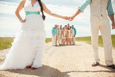Nice casual bridal party photo. Maybe show all of bride and groom???