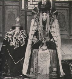 One of the most iconic things about Mongolian court dress was the 'horned' headdress the ladies wore. It is called an ugalz, and is a combination hairpiece and headdress.