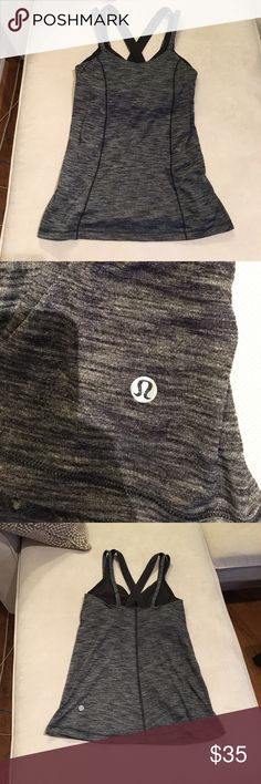 Black and grey Lululemon workout top This top is in like new condition, very comfortable and size dot verified, it has a built in bra. I ❤️ offers! lululemon athletica Tops