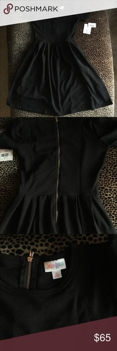 LuLaRoe Noir Collection Small Amelia NWT Brand new solid black Amelia from the Noir Collection. I tried it on once and it is NWT. Has a rose gold zipper. LuLaRoe Dresses Midi