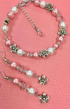 Earrings and bracelet set pink crystals pearls and flowers - October 13 2019 at Sea Glass Jewelry, Wire Jewelry, Jewelry Sets, Jewelery, Bracelet Making, Bracelet Set, Jewelry Making, Beaded Jewelry Designs, Jewelry Patterns