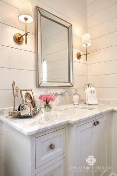 Master bathroom features a white vanity topped with marble under a faucet lining a curved marble backsplash and a beveled beaded mirror, Restoration H… - Marble Bathroom Shiplap Paneling, Paneling Ideas, Planked Walls, Wainscoting, Beaded Mirror, Farmhouse Renovation, Chic Bathrooms, Farmhouse Bathrooms, Master Bathrooms