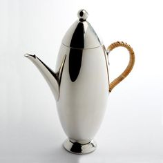 Tin Tin coffee pot from Nick Munro; Rocket shaped 18/10 stainless steel coffee pot with stainless steel or hand applied wicker handle. 700ml capacity. Also available in pewter and handmade in England.