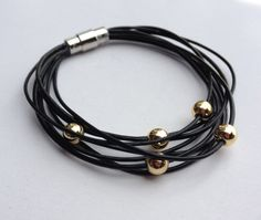 Leather orbit bracelet - leather cord accented with gold beads, magnetic clasp