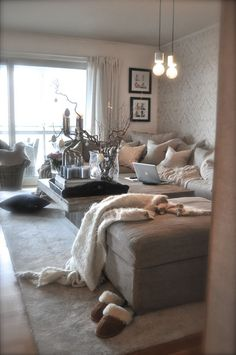 Love the cozy, romantic vibe along with the big windows and light color throws and decor to lighten up the room in the day. love the light colors