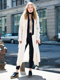 A silk shirt is paired with a long trench, skinny jeans, oxfords, and a skinny scarf