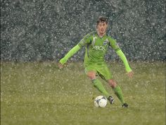 Brad Evans of the Seattle Sounders brings the ball up field during a snowstorm during a game against the New York Red Bulls at Kino Sports Complex in Tucson.