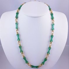 Check out this item in my Etsy shop https://www.etsy.com/listing/260181405/carved-jade-necklace-gold-vermeil-links