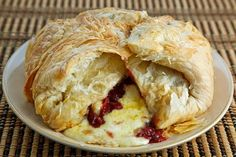 BAKED BRIE WITH CRANBERRY SAUCE  Have made this several times... instead of Puff pastry used Pillsbury Crescent Rolls.... Easier to find ... Easier to work with and THE TASTE IS JUST AS GOOD IF NOT BETTER. Also, try Seedless Raspberry Jam as a Topping! Excellent!
