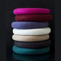 """Available in 7 fun colors, our hand felted cushions from Nepal offer stylish comfort to any space in the house. Easy care wool felt can be spot treated for stains, making them perfect for kids and adults alike!     15"""" diameter      Original Price $84.00"""