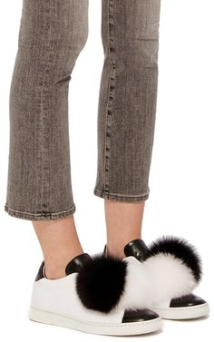 On a simple white body, this pair by **Joshua Sanders** features plush fur balls on each foot to easily add flair to your look.