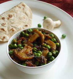 Matar Mushroom Fry / Mushroom and Peas Stir Fry recipe - an easy Indian stir fry recipe using button mushrooms and green peas - good side dish for rotis or rice.