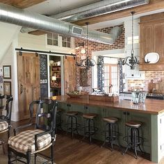 Love this farmhouse kitchen with exposed duct work and brick walls - part of this farmhouse tour eclecticallyvintage.com