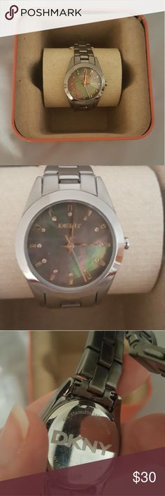 DKNY Watch Excellent condition DKNY watch. Purchased REFURBISHED  but shows no signs of wear. Gunmetal with a dark mother of pearl face. Has been adjusted to fit my small wrist, but I still have the extra links. Comes in a super cute Fossil tin. On the band the middle portion is shiny while the outer portion is more matte. NEEDS NEW BATTERY.  Reasonable offers considered and usually accepted  No trades  Bundle and save! DKNY Accessories Watches