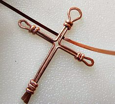 Place the center of the half round wire behind the cross, flat side facing you