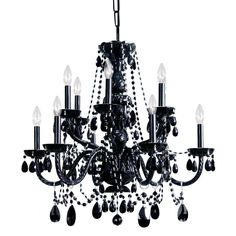 This chandelier features a black finish with hand-cut crystal accents. The fixture supports 12 lights and measures 26 inches high.