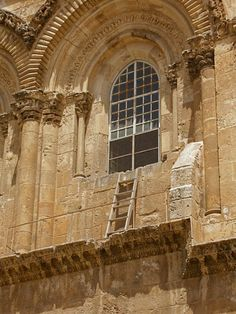The Immovable Ladder under the window of the Church of the Holy Sepulchre   Church of the Holy Sepulchre, Old City of Jerusalem