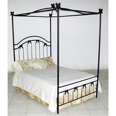 This hand forged iron bed by Corsican has a classic style and timeless appeal. Made by skilled craftsmen who uphold a tradition of handcrafted beauty, attention to detail and a commitment to quality