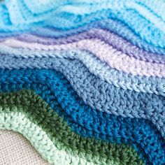 The gentle ripple pattern of this afghan evokes undulating ocean waves. Its colors vary from the pale blue of Bahamian tidepools to the indigo waters of the Gulf of Mexico. It& perfect for those longing for more adventures on the high seas. Crochet For Beginners Blanket, Crochet Patterns For Beginners, Baby Blanket Crochet, Crochet Afghans, Crochet Edgings, Beginner Crochet, Crochet Baby, Baby Afghans, Chrochet