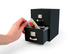 12. This mini filing cabinet for business cards. | Community Post: 14 Items Anyone Who Works In An Office Needs To Own