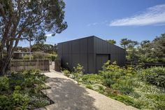 Melbourne-based architecture and interior design practice engaged in projects large and small, with a particular interest in housing and projects that nurture community. Clare Cousins, Sorrento Beach, Garden On A Hill, Back Gardens, Black House, Landscape Design, House Plans, Shed, Exterior