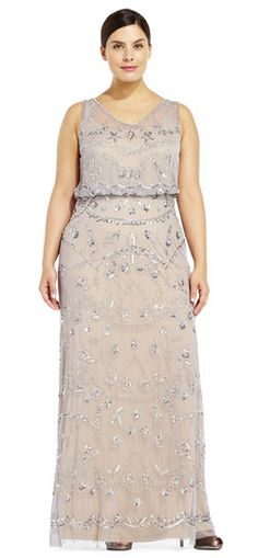 Delicate and feminine beading abounds on this pretty evening gown. This elegant dress features a sleeveless blouson bodice, illusion neck and back, and a flowing skirt. Paired with metallic heels, this gown is the epitome of ladylike beauty.