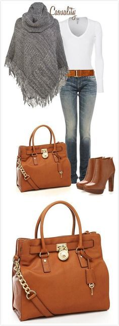 I adore Michael Kors shoes and bags. I really like the belt in this one as well as the style of the boot and the shawl.
