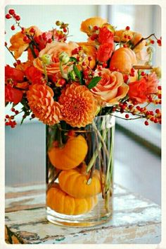 These beautiful, rich orange hues are the perfect compliment to any rustic wedding table-setting ~ simply gorgeous!! #benevaweddings #benevaflowers #rustic #orange #fallweddings #elegant #centerpieces