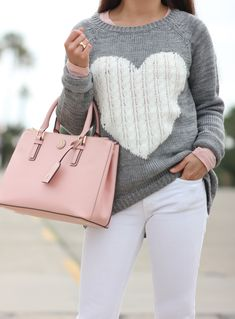 Heart Print Sweater, white jeans, Tory Burch pink purse   // Click the following link to see outfit details and photos:   http://www.stylishpetite.com/2015/02/heart-print-sweater.html