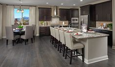 Looking for a Richmond American community in Las Vegas or Henderson? Espresso Kitchen Cabinets, Modern Kitchen Cabinets, Kitchen Flooring, Grey Kitchen Floor, Dark Cabinets, Home Decor Kitchen, Kitchen Living, Home Kitchens, Kitchen Design