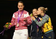 AUGUST 01: (L-R) Silver medalist Sofya Velikaya of Russia, gold medalist Jiyeon Kim of Korea and bronze medalist Olga Kharlan of Ukraine pose on the podium during the medail ceremony in the Women's Sabre Individual Fencing Gold on Day 5 of the London 2012 Olympic Games at ExCeL on August 1, 2012 in London, England. (Photo by Hannah Johnston/Getty Images)