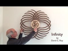 Winding the Infinity Kinetic Sculpture by David C. Roy - YouTube