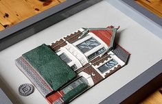 Was so pleased to be asked to frame this clay house by Lloyd Owen Clayart. I just love it and the attention to detail is amazing. Every brick, tile, beautifully rendered. I was commissioned to set it into a box frame with the outer colour matching the grey roof tiles and the inner slip painted a lighter shade of grey.