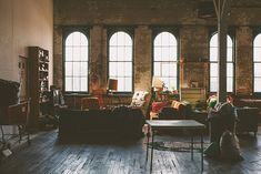 Baltimore artist studio space-love the brick walls and the windows and the wood floors and the high ceilings