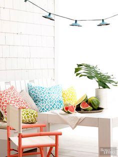 Add brilliant doses of color to your almost all-white porch with everyday accessories.