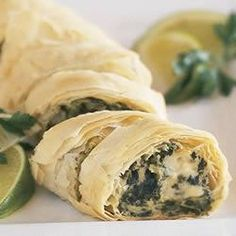 Make-Ahead PHILLY Spinach Phyllo Roll-Ups Allrecipes.comI've been making these for a few years and they are ALWAYS a hit. I like including ingredients sometimes, like sprinkling a little creole seasoning on the inside of the roll. They'd also be good with a little crab meat and Old Bay seasoning...I haven't tried that yet, I don't think.