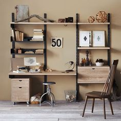 The industrial steel frames and solid oak shelves, drawers and cabinets create sturdy, versatile heirloom pieces — perfect for a small home office space!
