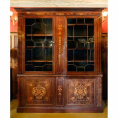 Victorian mahogany inlaid bookcase | Antique Furniture | Andy Thornton