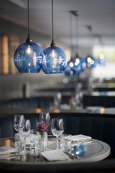 Round glass pendant lights by Curiousa & Curiousa, hanging over dining table at Neighbourhood restaurant. Pendant Lighting Over Dining Table, Kitchen Pendant Lighting, Kitchen Pendants, Glass Kitchen, Kitchen Reno, Kitchen Island, Kitchen Ideas, Glass Light Shades, Glass Pendant Shades