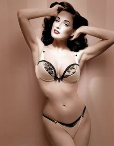 Dita in a nude satin wonderbra and thong