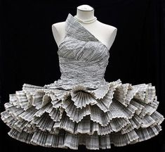 Paper Dress (Jolis Paons) Designer Jolis Paons created this elegant dress from the pages of a telephone directory, a stunningly inventive use of recycled material via Today in Art - love the ruffles!