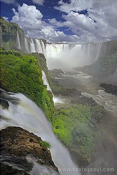 Iguazu Falls, Argentina theres a bridge for tourist to walk out on into the middle falls looks amazing that would be great to see someday, added to the bucket list