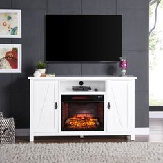 Clean white finish creates a quiet touch, effortlessly bringing the unmistakable magic of farmhouse style into your living room, dining room, or studio apartment. This Farmhouse Style TV Stand Electric Fireplace brings the charm of the simple life into your busy routine. Entertainment center fireplace with an open media shelf holds your electronic accessories while broad mantel supports your flat screen TV. Storage cupboards on either side store games, movies, blankets, and everything else…
