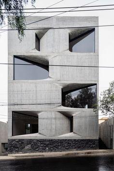 Windows punctuate board-marked concrete facade of DL1310 Concrete Facade, Concrete Building, Exposed Concrete, Building Facade, Concrete Board, Building Skin, New York Architecture, Concrete Architecture, Minimalist Architecture
