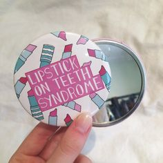 Image of Lipstick-on-teeth Syndrome Pocket Mirror
